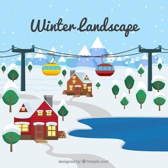 Invernale paesaggio di sfondo con le case e la funivia