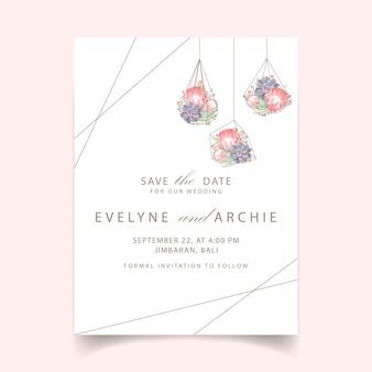 Invito a nozze floreale con fiore di protea e succulente in terrario