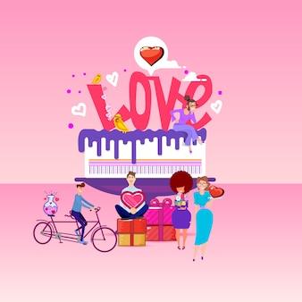 Iscrizione d'amore su una grande torta e piccole persone in giro.