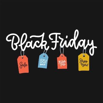 Iscrizione del venerdì nero in vendita con etichette colorate pubblicitarie su sfondo nero