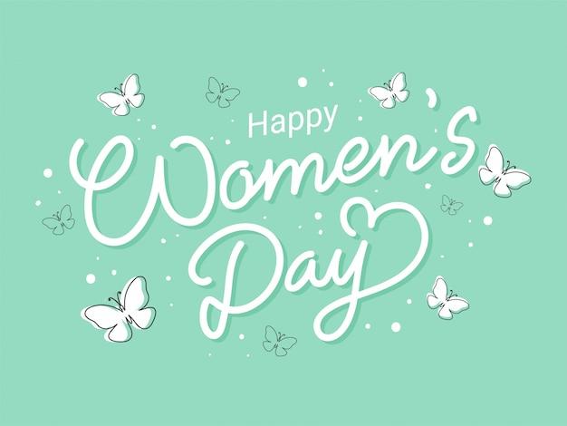 Iscrizione della giornata della donna felice con farfalle su verde pastello