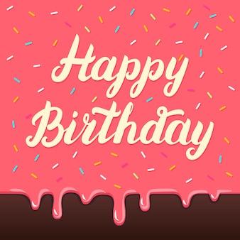 Iscrizione della mano di buon compleanno sulla carta della glassa della torta
