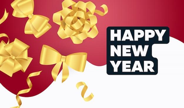 Iscrizione di felice anno nuovo con fiocchi di nastro dorato