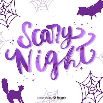 Iscrizione di notte spaventosa viola con ornamenti