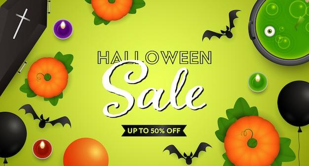 Iscrizione di vendita di halloween con pozione, zucche e pipistrelli