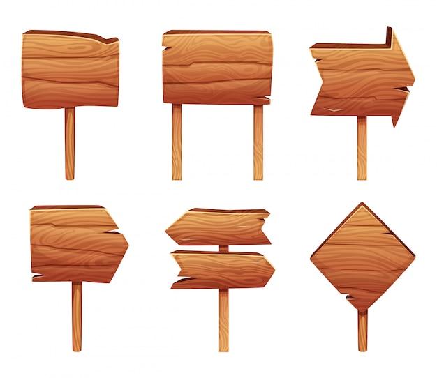 Isolato di legno dei segnali di direzione su bianco