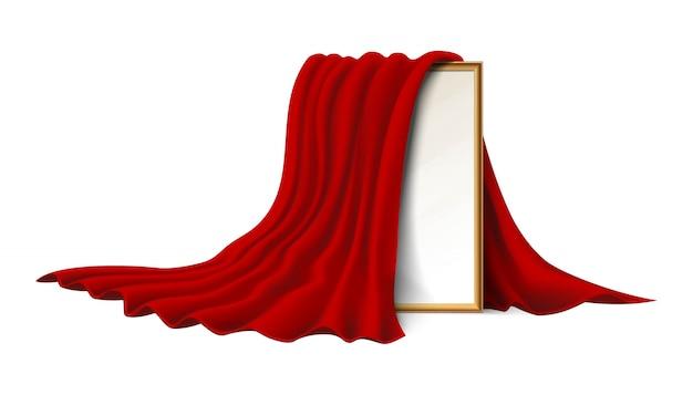 Isolato su sfondo bianco cornice di legno ricoperta da un panno di velluto rosso.