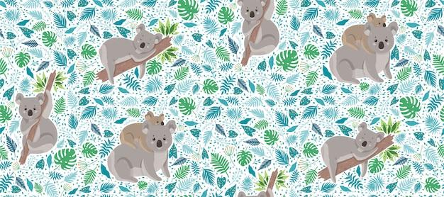 Koala carino circondato da foglie tropicali