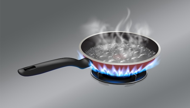L'acqua bollente nella padella viene posta su una stufa a gas.