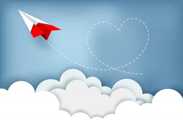 L'aereo di carta vola fino al cielo mentre vola sopra una nuvola