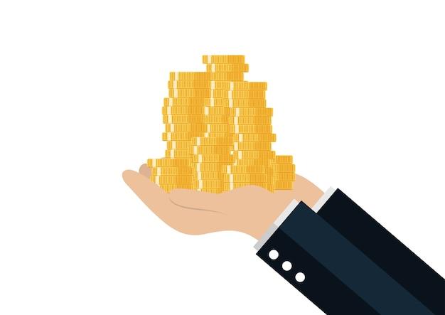 L'albero della holding della mano che cresce sulle monete impila con il fondo comune