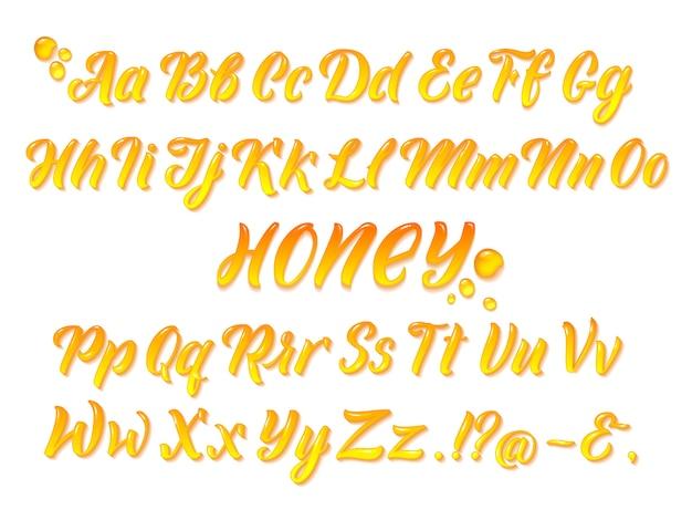 L'alfabeto latino honeyed liquido con oro spruzza. mano che scrive insieme di vettore di lettere gialle