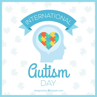 L'autismo sfondo giornata con il cuore di puzzle