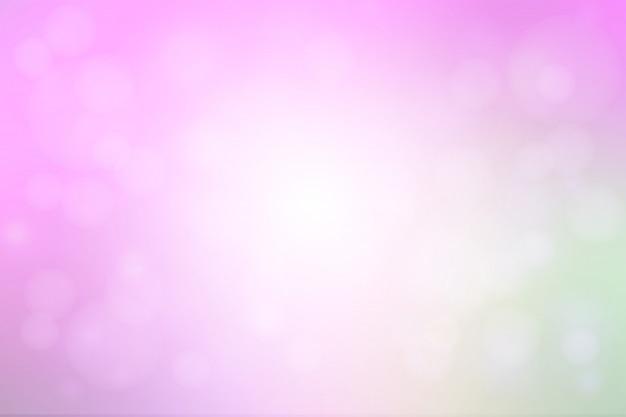 L'estratto rosa verde porpora con le luci del bokeh ha offuscato il fondo