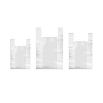 L'insieme dei sacchetti della spesa di plastica eliminabili vuoti bianchi con le maniglie si chiude su isolato su fondo bianco
