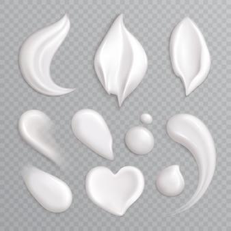 L'insieme realistico dell'icona delle sbavature della crema cosmetica con bianco ha isolato gli elementi differenti forme e illustrazione di dimensioni