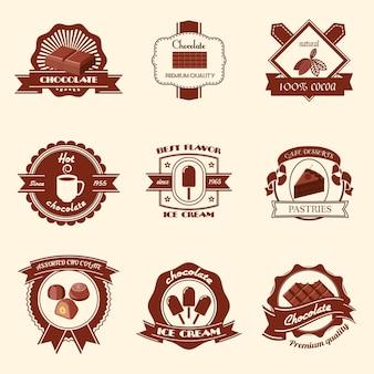 L'insieme stabilito del distintivo del gelato di sapore del cacao naturale di qualità premio del cioccolato ha isolato l'illustrazione di vettore