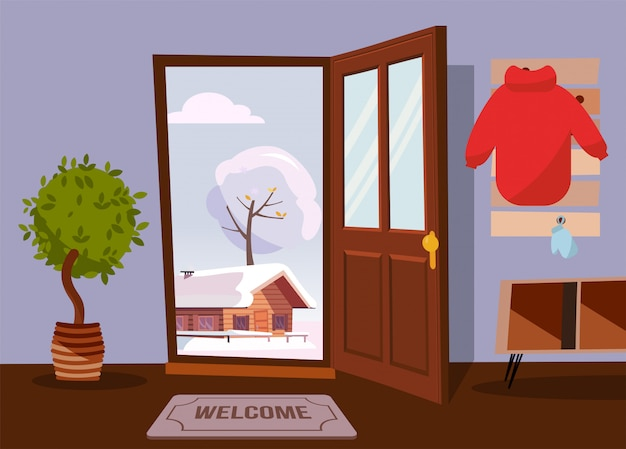 L'interno del corridoio con la porta aperta si affaccia sul paesaggio invernale con la vecchia casa