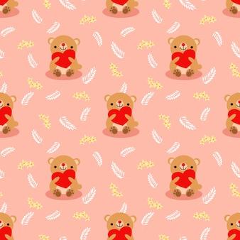 L'orso marrone sveglio tiene un modello senza cuciture del cuore rosso.