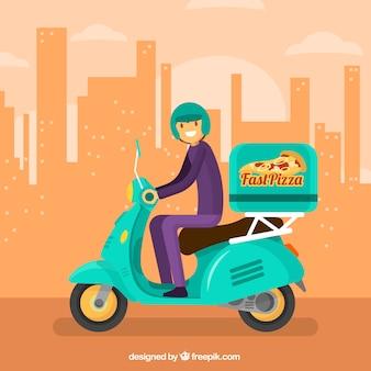 L'uomo bello di consegna della pizza e la città