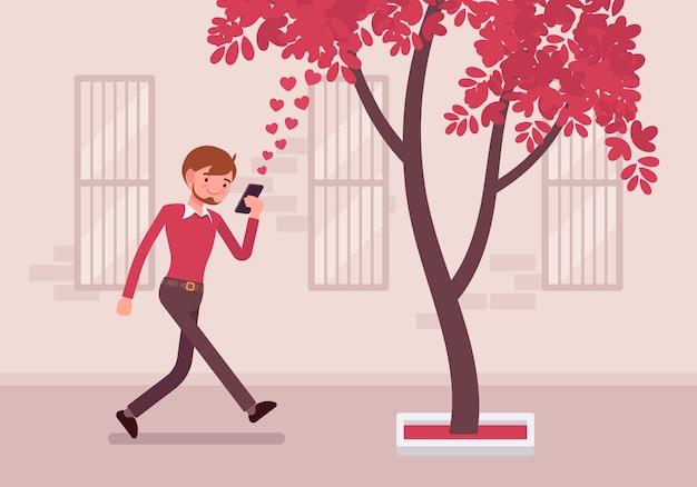 L'uomo cammina con lo smartphone per urtare un albero