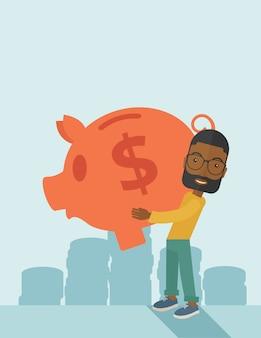 L'uomo d'affari africano porta un grande porcellino salvadanaio per il risparmio dei soldi.
