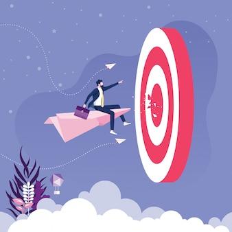 L'uomo d'affari che vola sull'aereo di carta va all'obiettivo. vettore concetto aziendale