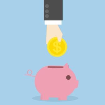 L'uomo d'affari entra nella moneta al porcellino salvadanaio, concetto di affari