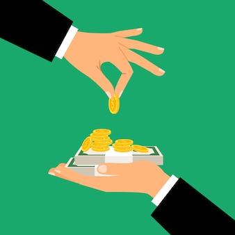 L'uomo d'affari passa le monete e le banconote della tenuta