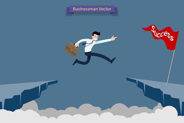 L'uomo d'affari salta sopra la scogliera per raggiungere il suo obiettivo di successo.