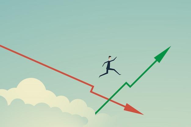 L'uomo d'affari salta sul grafico verde crescente