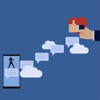 L'uomo d'affari sta sopra la bolla di commento attraverso il like e l'amore dei social media.
