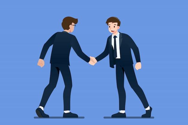 L'uomo d'affari sta stringendo la mano a vicenda.