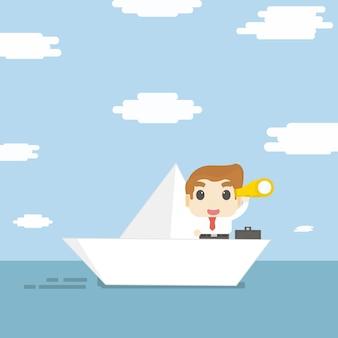 L'uomo d'affari sulla barca di carta cerca qualcosa