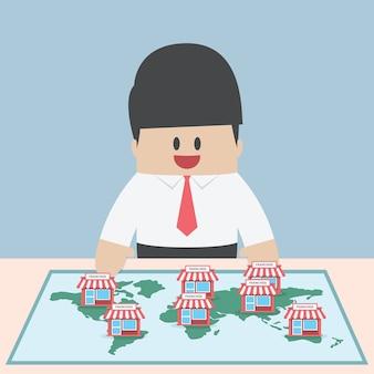 L'uomo d'affari vuole espandere la sua attività, concetto di franchising