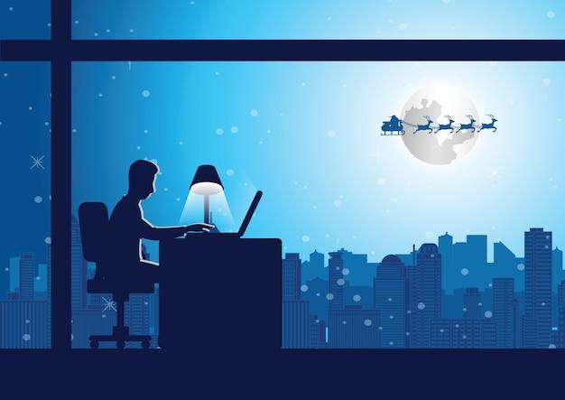 L uomo fa gli straordinari in ufficio nella notte di natale
