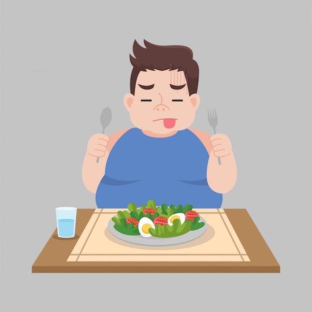 L'uomo grasso infelice non vuole mangiare i cibi dell'insalata di verdure