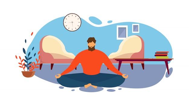 L'uomo medita sulla posizione del loto in salotto