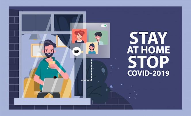 L'uomo resta a casa evitando di diffondere il coronavirus durante il covid-19. lavora da casa per una vita sicura.