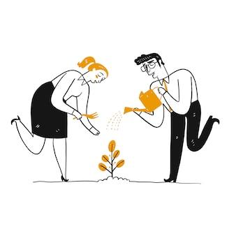 L'uomo sta innaffiando una pianta