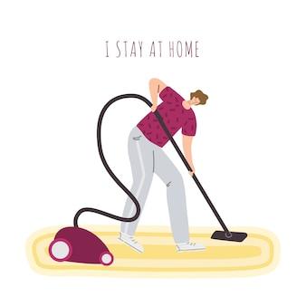 L'uomo sta pulendo la stanza a casa con un aspirapolvere, sta a casa le attività per le persone