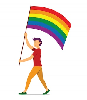 L'uomo tiene la bandiera arcobaleno per il movimento lgbt.