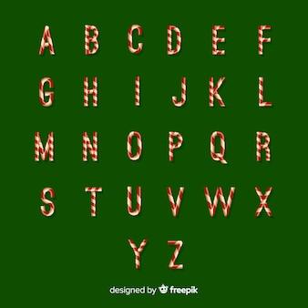 La canna di caramella segna l'alfabeto con lettere di natale