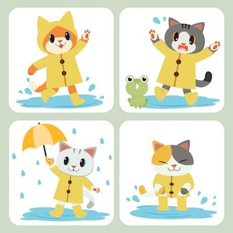 La collezione di simpatici gatti indossa l'impermeabile giallo, l'ombrello e gli stivali.