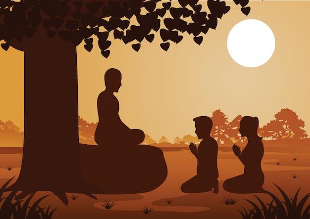 La coppia buddista paga rispetto al monaco