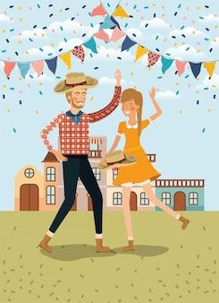 La coppia degli agricoltori che celebra con le ghirlande e il paesaggio urbano