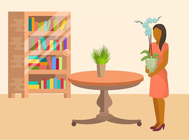 La donna che organizza le piante ed i fiori domestici nella sala ammobiliata con gli scaffali di libro e della tavola vector l'illustrazione nello stile piano del fumetto. donna che passa il tempo a casa.
