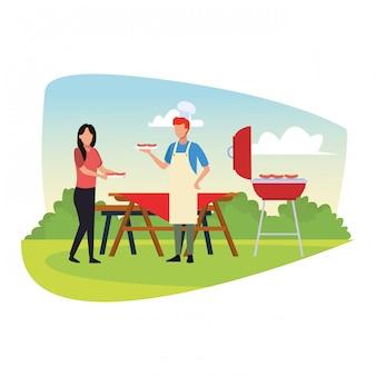La donna e l'uomo dell'avatar che cucinano in un bbq grigliano