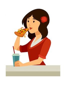 La donna italiana con rosa nei capelli mangia la pizza