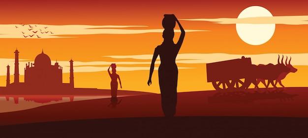 La donna porta acqua per l'uso di routine